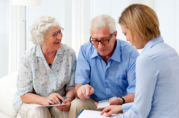 Elderly couple and consultant